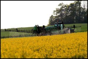 Farm machinery spraying crops